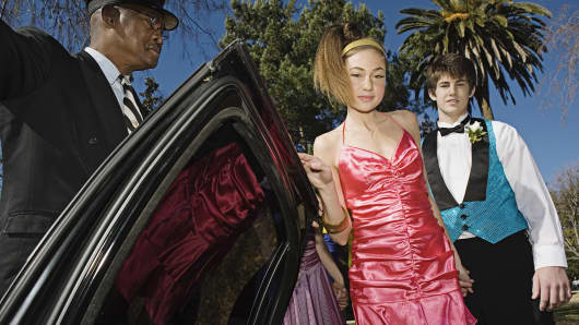 Prom couple getting into limousine