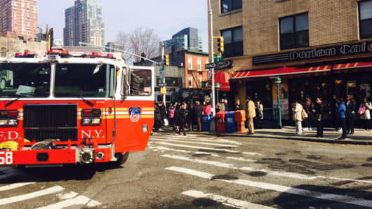 Firefighters respond at Vernon Boulevard and Jackson Avenue in Queens, New York.