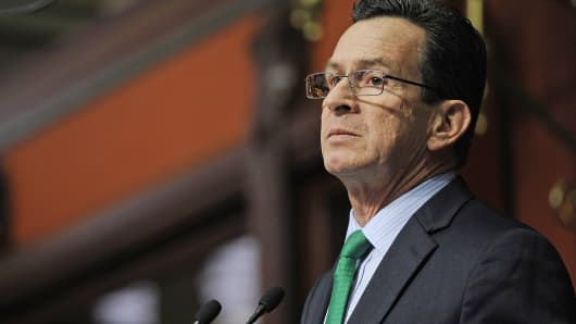 Connecticut Gov. Dannel P. Malloy delivers his budget address to the senate and house inside the Hall of the House at the State Capitol, Feb. 18, 2015, in Hartford, Conn.