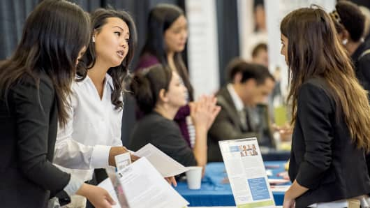 Recruiters speak with job seekers during a career fair at the San Francisco State University in San Francisco.