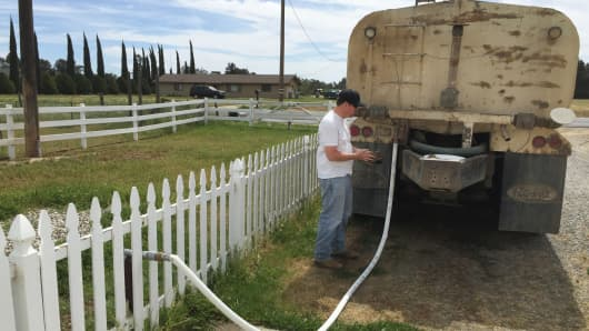 Water truck delivery at home just outside Clovis, California.
