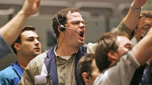 Traders signal transactions in the 10-year Treasury Note options pit at the Chicago Board of Trade.