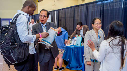 Job seekers speak with recruiters during a career fair at San Francisco State University, April 3, 2015.