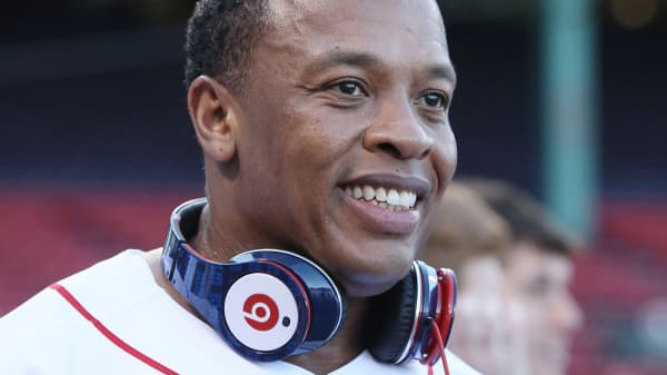 Dr. Dre with Beats by Dr. Dre headphones