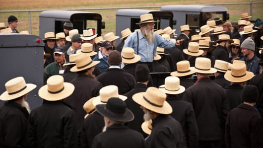 Amish bidders listen to the auctioneer during the Annual Mud Sale to support the Fire Department March 12, 2011, in Gordonville, Pennsylvania.