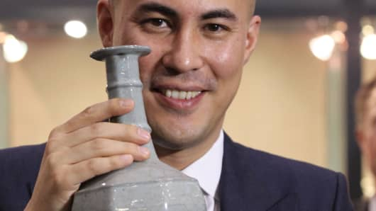 Nicolas Chow, International Head of Chinese Ceramics and Works of Art at Sotheby's, shows off a Southern Song dynasty-era vase that sold for $14.6 million in Hong Kong.
