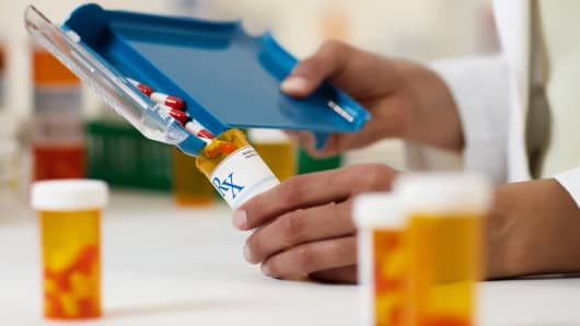 Pharmacist dispensing pills