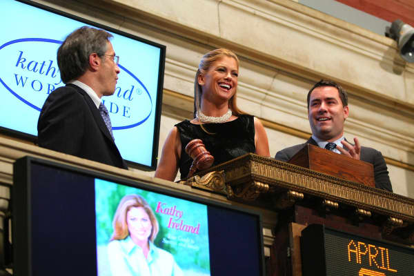 Larry Leibowitz, Kathy Ireland and President and COO of Kathy Ireland Worldwide Stephen Roseberry ring the closing bell at New York Stock Exchange on April 9, 2009, in New York City.