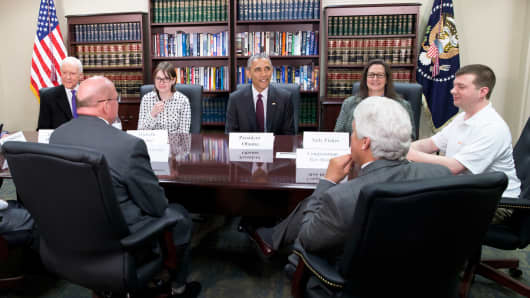 "President Barack Obama participates in a roundtable about clean energy, Friday, April 3, 2015, at Hill Air Force Base, Utah. Seated with the president starting with the president and going clockwise are: Obama, Judy Fisher, Marvin Lance Futch, Rep. Rob Bishop, R-Utah, Harry ""Buddy"" Briesmaster III, Sen. Orrin Hatch, R-Utah, and Michelle Fisher. Thaniel Bishop and Salt Lake City Mayor Ralph Becker are also at the table but not shown."