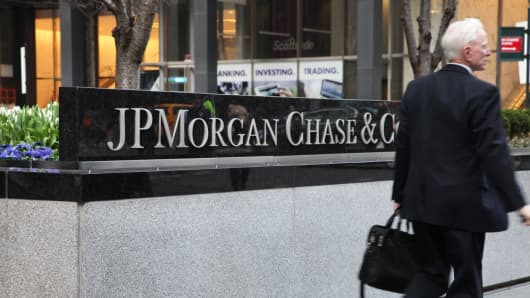 A pedestrian walks past the JPMorgan Chase headquarters building in New York.