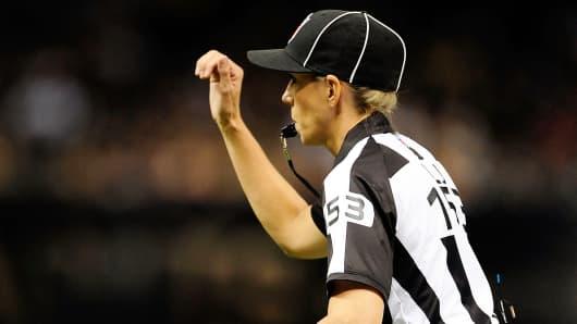 Sarah Thomas makes a call during an NFL preseason game in 2013.