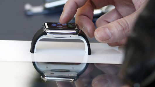 Shopper looking at an Apple Watch