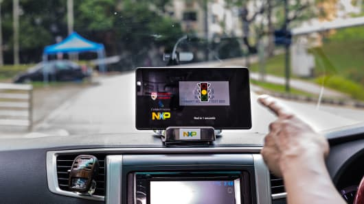 The NTU-NXP V2X test bed demonstrating how a driver receives information about an upcoming traffic light.