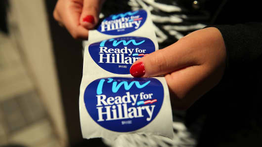 Stickers are handed out to supporters of Hillary Clinton at a rally in Manhattan on April 11, 2015, in New York City.