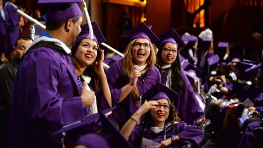 Recent college graduates at commencement from Hunter College in New York City.