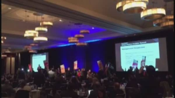 Protestors disrupt hedge fund conference