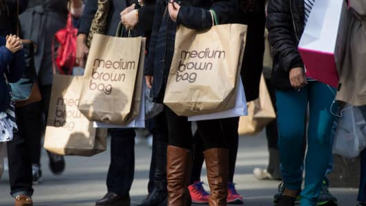 Pedestrians carry Bloomingdale's shopping bags while walking in New York.