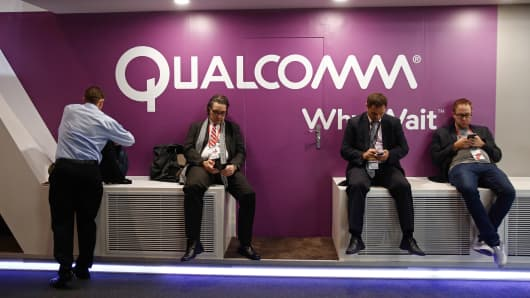 Visitors sit at the Qualcomm pavilion at the Mobile World Congress in Barcelona, Spain last month.