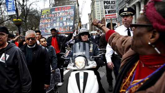 Demonstrators protest against police brutality against minorities during a protest in New York, April 14, 2015.