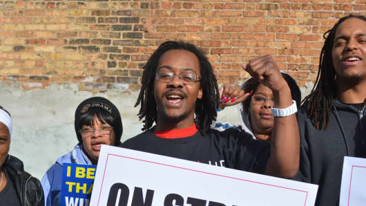 Carlos Jefferson. who works for McDonald's in Milwaukee, was among fast food workers protesting on Tax Day for a $15-an-hour national minimum wage.
