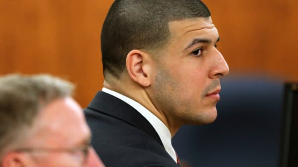 Former National Football League player Aaron Hernandez (R) waits for a verdict in Fall River, Massachusetts, April 14, 2015.