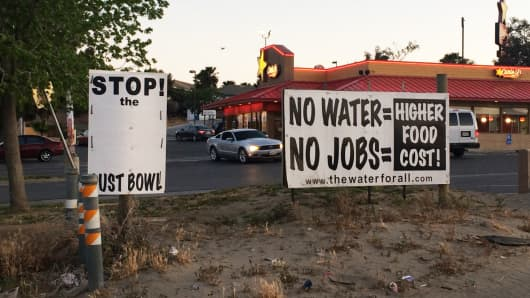 Signs referring to the water shortage in Kettleman, California's Central Valley.