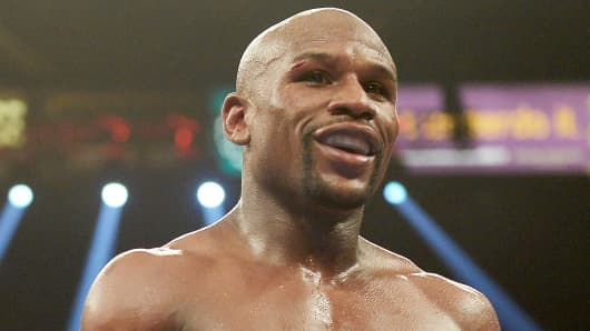 Floyd Mayweather Jr. smiles during a fight against Marcos Maidana in Las Vegas.