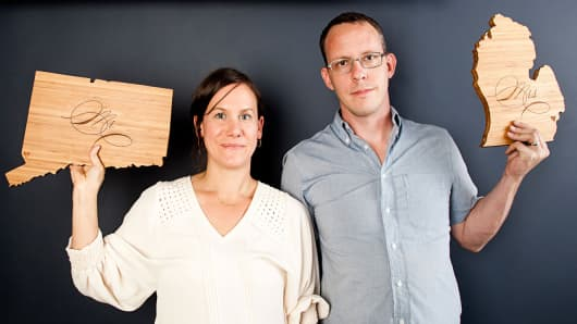 At their shop AHeirloom, Amy Stringer-Mowat and Bill Mowat craft popular, state-shaped wood cutting boards.