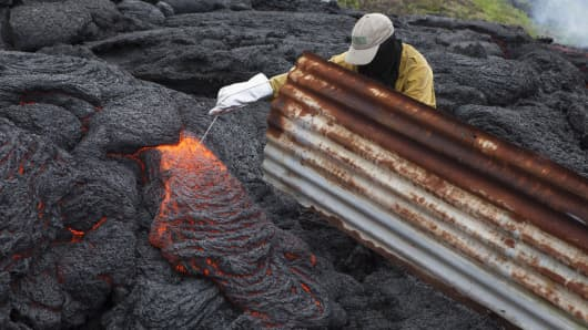 Geologist Matt Patrick at work monitoring volcanoes for the Hawaiian Volcano Observatory.