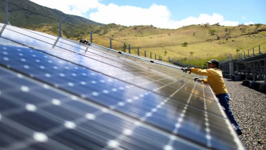 A worker cleans the panels in a solar power park run by the Costa Rican Electricity Institute (ICE) as the power company has managed to produce all of the electricity for the nation from renewable energy sources for more than 80 days straight on March 26, 2015 in Guanacaste, Costa Rica.