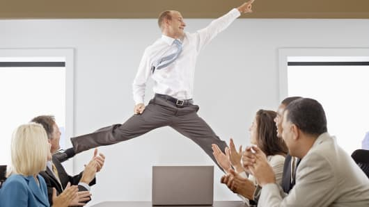 Businessman jumping during meeting