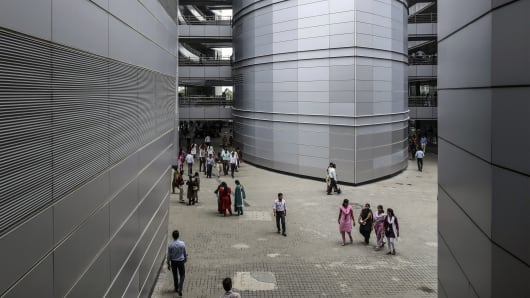 Employees walk through the Tata Consultancy Services Ltd. (TCS) campus in the State Industries Promotion Corporation of Tamil Nadu Ltd. (SIPCOT) IT Park in the Siruseri area of Chennai, India.