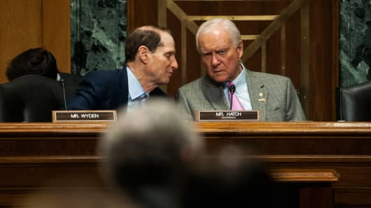 Ron Wyden (D-OR), left, and Chairman Orrin Hatch (R-UT), speak during the Senate Finance Committee hearing on Congress and U.S. Tariff Policy on April 16, 2015 in Washington.