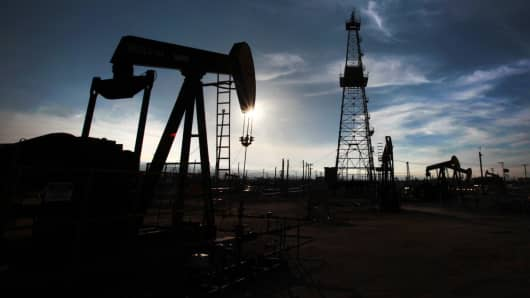 Oil pumps and drilling equipment in an oil field in Kern County, where the majority of California's oil and gas production in Shafter, California.