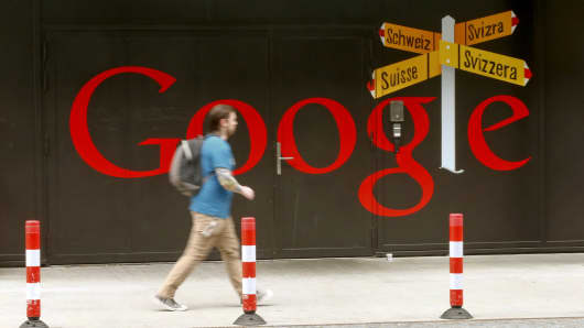 A man walks past a logo at Google's European Engineering Center in Zurich April 16, 2015.