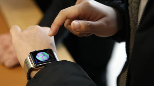 A businessman tries on Apple Watch.