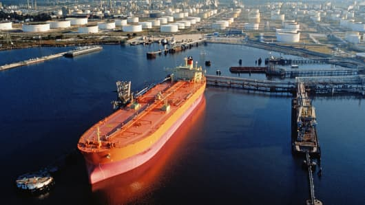 An oil tanker ship is shown moored at the loading bay of an oil refinery in Houston.
