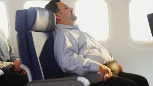 Overweight airline passenger in seat