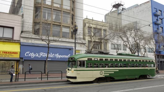 An F-Line streetcar makes its way past a number of vacant storefronts on Market Street in San Francisco. For years, San Francisco leaders have tried unsuccessfully to revitalize the city's downtrodden Mid-Market Street area, where tourists are scarce and crimes frequently unfold in broad daylight.