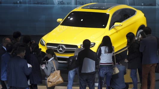 Visitors walk around a Mercedes Benz concept GLC Coupe car during the 16th Shanghai International Automobile Industry Exhibition in Shanghai, April 20, 2015.