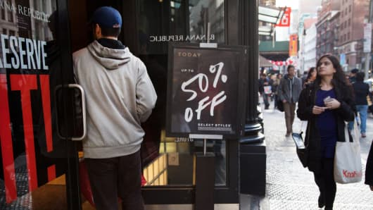 Shoppers pass a Banana Republic store in New York