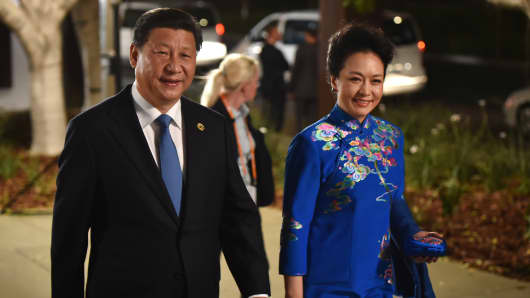 China's President Xi Jinping and his wife Peng Liyuan arrive at the Gallery of Modern Art in Brisbane as he takes part in the G-20 Summit.