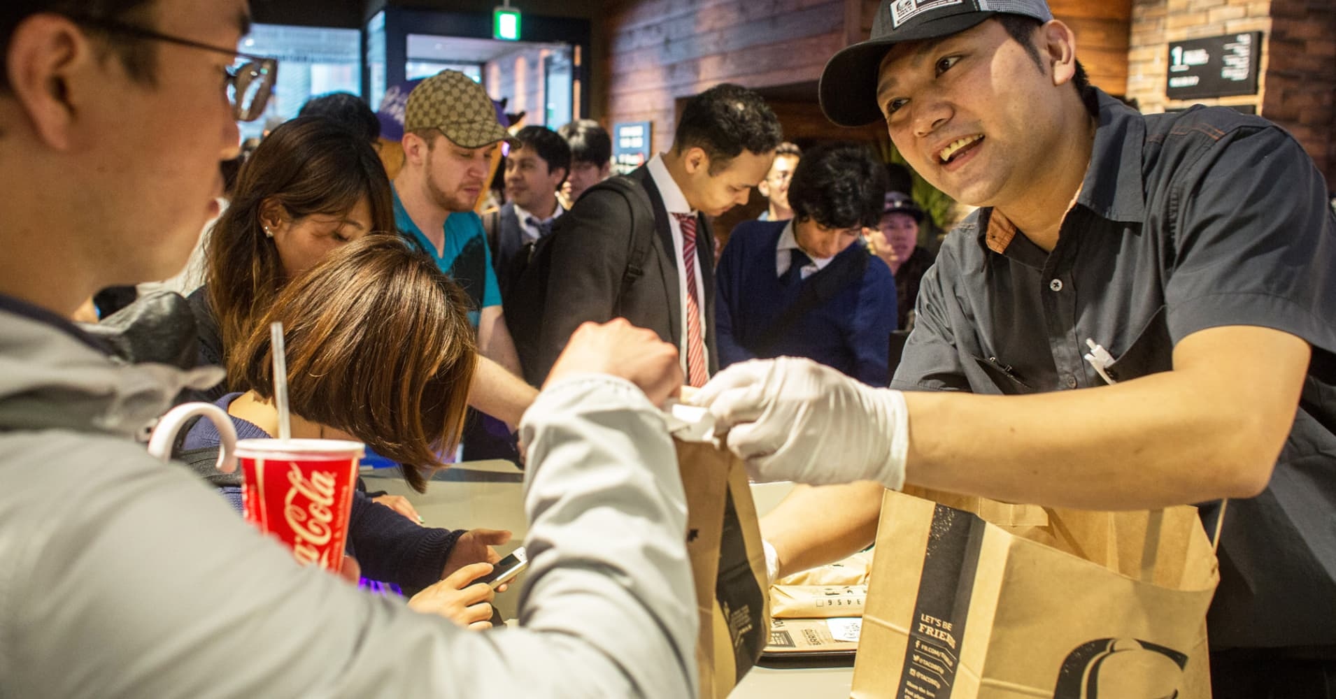 A man receives his order at the new Taco Bell during the official opening on April 21, 2015 in Tokyo.