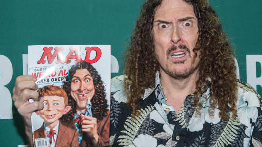 Weird Al Yankovic signs copies of Mad Magazine on April 20, 2015, in New York City.