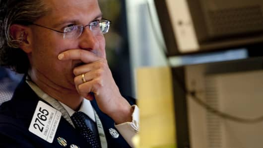 Donald Civitanova works at a post on the floor of the New York Stock Exchange in New York, U.S., on Thursday, May 6, 2010.