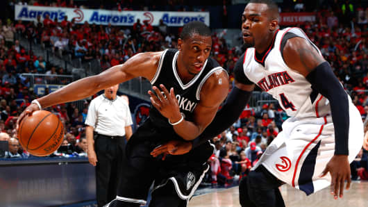 Thaddeus Young of the Brooklyn Nets drives against Paul Millsap in the NBA Eastern Conference Quarterfinals on April 19, 2015, in Atlanta.