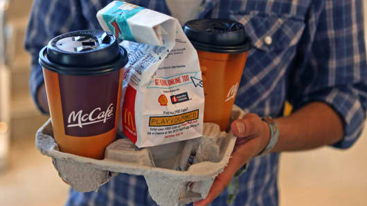 A customer carrying an order at a McDonald's restaurant.