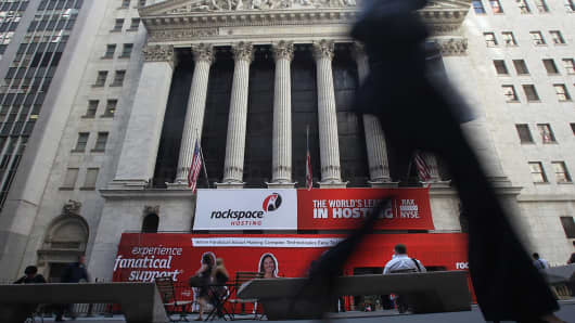 "A woman walks past the New York Stock Exchange on May 6, 2010, the day of the ""Flash Crash."""