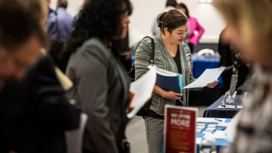 Job seekers speak with representatives at the Choice Career Fair in San Antonio, Texas.