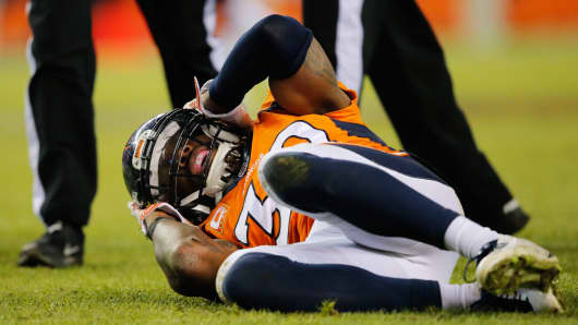 David Bruton of the Denver Broncos lies on the ground with a reported concussion, December 28, 2014.
